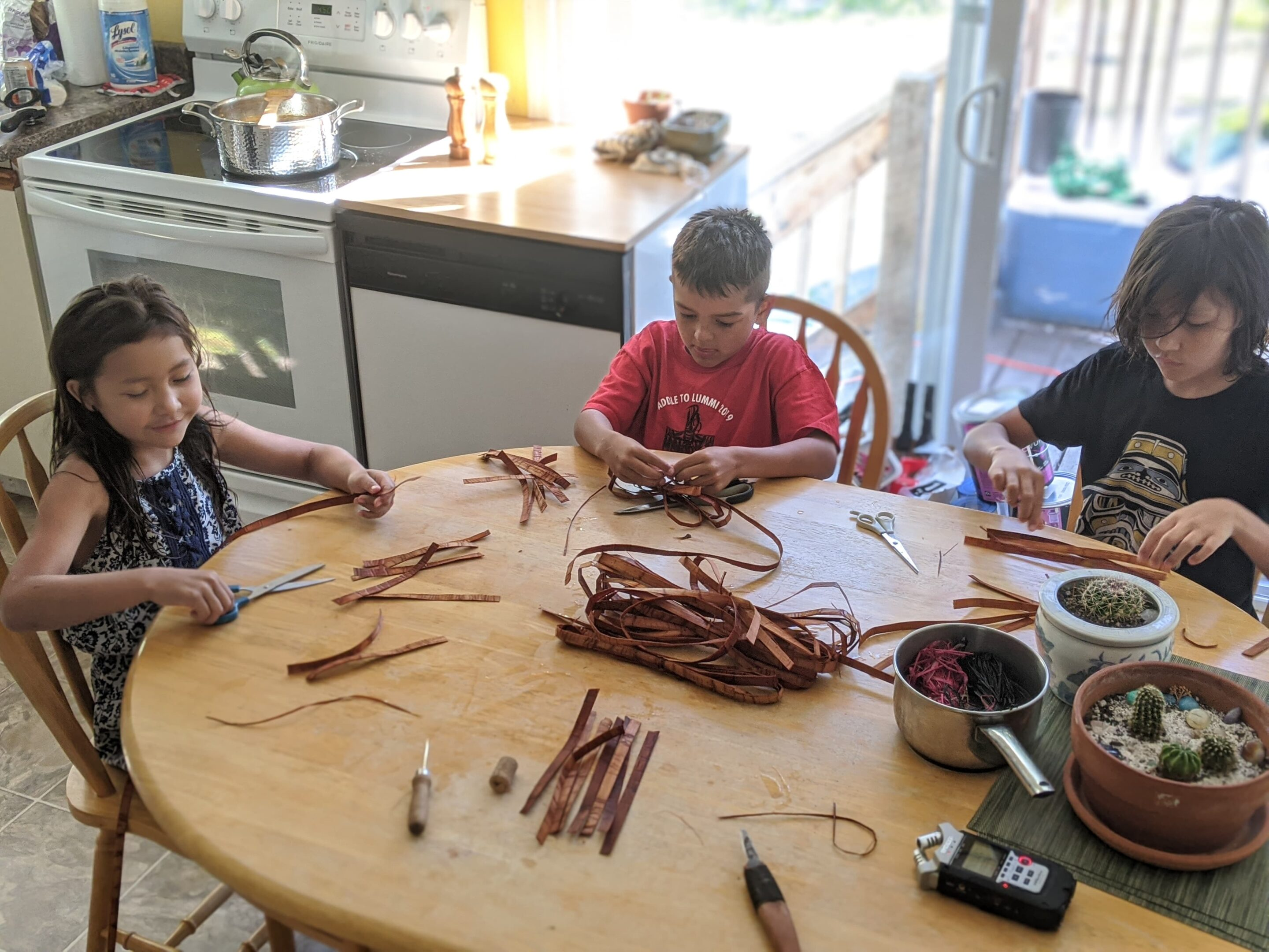 Tla'amin weaver Sosan Blaney teaching a class to youth with soundscapes of Indigenous artists
